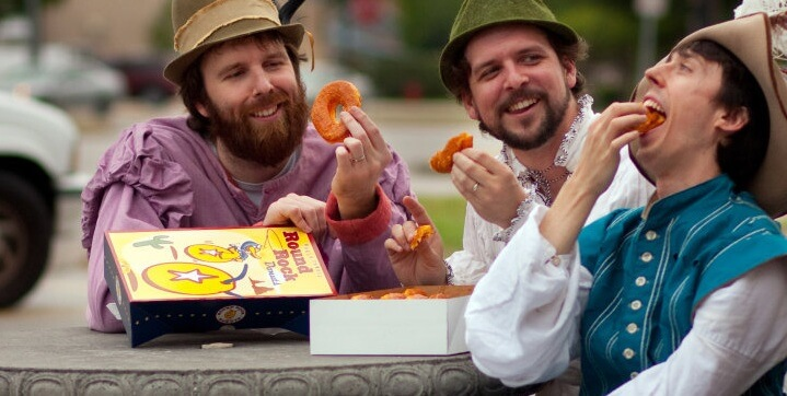 Nathan Jerkins and Ryan Crowder enjoy round rock donuts in costume