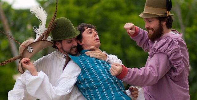 Nathan Jerkins grabs Ryan Crowder by the throat in The Complete Works of Shakespeare (Abridged)